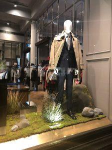 Aquascutum fashion bespoke prop manufacture moss reeds mirror plinths artificial rocks visual merchandising production window display